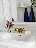 Washbasin with vintage, brass taps