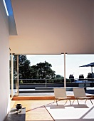 Living room with sliding glass doors leading to roof terrace
