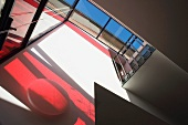 Glass wall with red shadows and glass roof