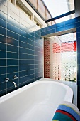 Bathroom with blue tiles and skylight