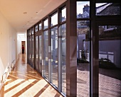 Long corridor with glass wall leading to terrace