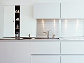 Detail of kitchen unit with white doors