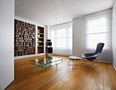 Minimalist room with classic armchair and footstool