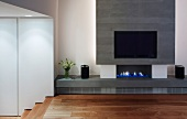 Modern fireplace with integrated flat-screen TV