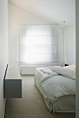 White bedroom with closed blinds on window