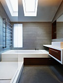 Designer bathroom with skylights and made-to-measure installations in attic storey