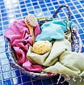 Bathing utensils in a basket on blue tiles