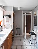 Kitchen with white floor tiles