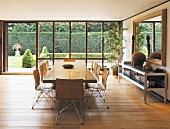 Long dining table and chairs in open-plan room