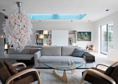 Bright living room with designer lamp and skylight