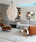 Designer lamp in living room with grey and brown seating