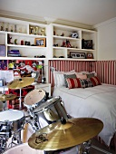 Teenager's bedroom with drum kit