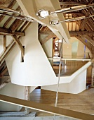 Deconstructivist installations in historic roof structure of converted house