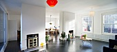 Wall elements with converted fireplaces in open-plan, sunny living space in an old building in London