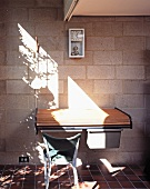 Sunny designer workstation with roll top desk against unrendered wall