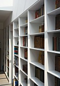 Tapered edge profiles make made-to-measure shelving appear slender and light