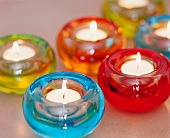 Multi-coloured glass tea light holders