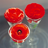 Red flowers in glass goblets