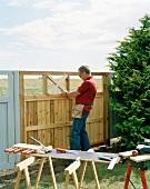 Man repairing a fence