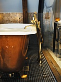 Antique copper bathtub with brass tap fittings