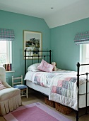 Child's bedroom with bed and patchwork bedspread