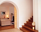 Modernised foyer with open sliding door and view into living room through rounded arched doorway