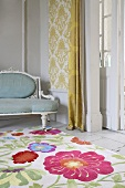 Cheerful floral pattern on rug in front of upholstered, Rococo-style bench