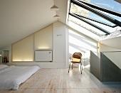 Minimalist bedroom beneath half-glazed roof