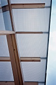 Detail of roof overhang - roof of plastic panels on wood beam frame