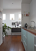 Modern kitchen counter in niche and view of sideboard through floor-to-ceiling doorway