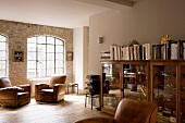 Comfortable living room with leather armchairs in former factory