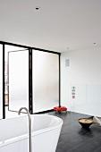 Designer bathroom with open terrace door