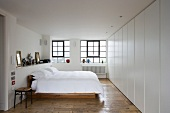 Modern furnishings in bedroom with old floorboards