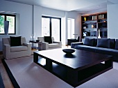 Elegant designer living room with cubist coffee table and sofa set