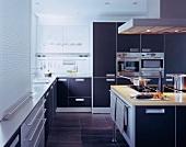 Food preparation on kitchen island in designer kitchen