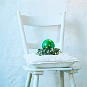 White chair with cushion and Christmas decor