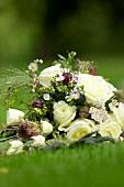 Bridal bouquet lying on lawn