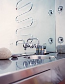 Stainless steel washstand and designer tap fittings on mirror