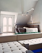 Light, designer corner couch in front of stylish dining area in a classic setting
