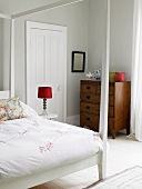 Bedroom with canopied bed & old chest of drawers