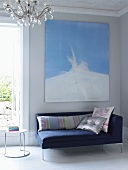 Modern, blue recamier and painting in living room