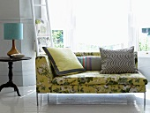 Floral recamier with scatter cushions