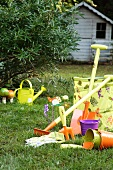 Garden tools & garden ornaments on lawn