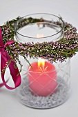 Candle in jar decorated with heather wreath
