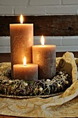 Festive table decor with wreath & three candles on silver plate