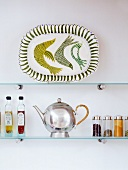 Glass shelf with platter, teapot, spices & oils