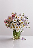 Posy of wild flowers with daisies & forget-me-nots