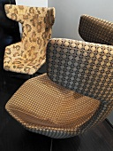 Mix of patterns on shell chairs with brown and beige covers