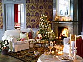 Festive Christmas atmosphere in traditional living room with blazing open fire