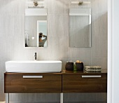 Dark wood washstand with counter-top washbasin in contemporary bathroom